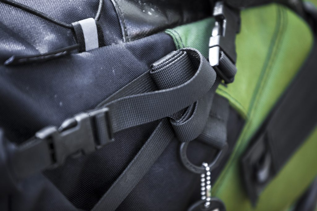 Detail shot of spanish handmade Cordel bikepacking bag, reflective tab