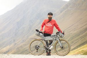 Staffan Widell proudly stands at the Colle delle Finestre with his Open UP gravel bike
